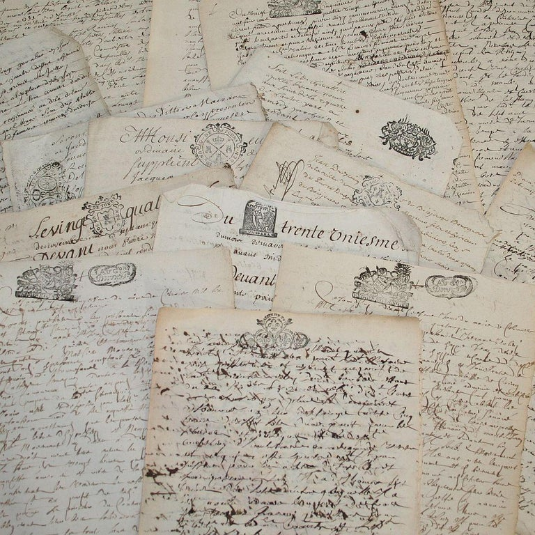 Bundle of 20 extremely old handwritings on paper, France, circa 1650-1800. Weathered.