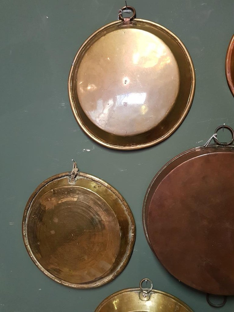 Fabulous collection of 9 antique French red and yellow copper cooking dishes with a layer of tin on the inside that have wear consistent by age and use.  The measurements are and smaller ones, Diameter 31.5 cm/ 12.4 inch. Height 7 cm/ 2.7 inch.