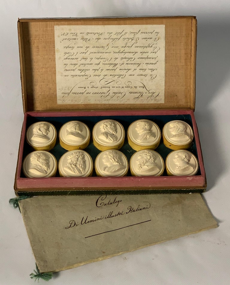 A very rare and complete souvenir of the Grand Tour, a collection of early 19th century plaster intaglios depicting eminent men of Italy in original blue leather box with hand written catalogue and Roman dealer's label.