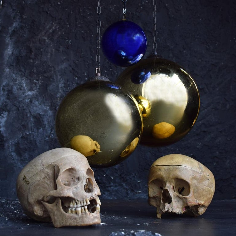 Collection of early 20th century mercury glass witches' balls We are proud to offer a collection of 3 early 20th century mercury glass witches' balls. In various sizes and gold and cobalt blue, all attached to their original brass handing galleries