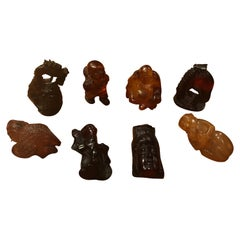 Collection of Eight Japanese Amber / Resin / Bakelite Netsukes