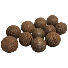 Collection of Eleven 19th Century French Iron-Studded Wooden Pétanque Balls