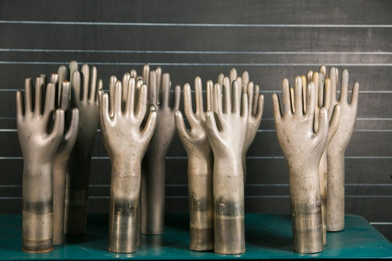 French Collection of Eleven Aluminum Glove Molds For Sale