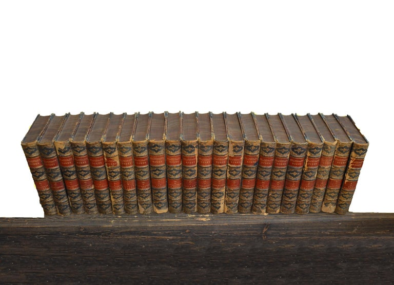 This attractive collection of leather-bound English Literature books contains a group of 22 books, in a warm rich tone of tan and black, with red trim and gold leaf embossing. Aside from a few books that have minor scuffs and scratches along with
