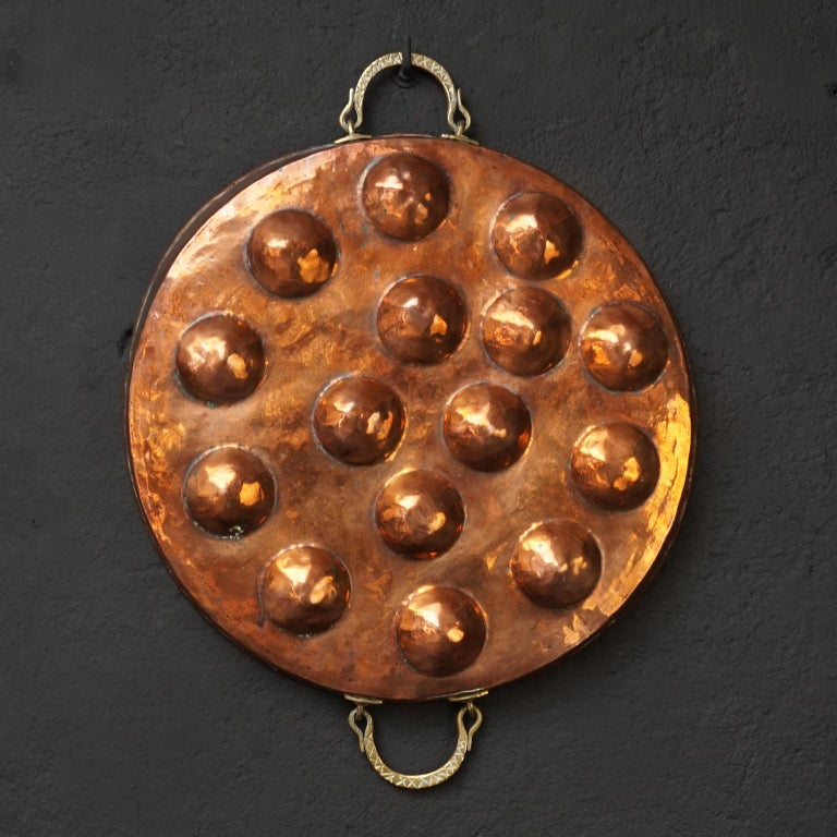 Collection of Fifteen 19th Century French Copper Egg Poacher or Escargot Pans For Sale 7