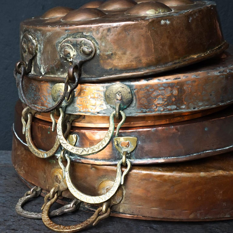 Collection of Fifteen 19th Century French Copper Egg Poacher or Escargot Pans For Sale 8