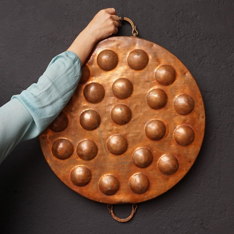 Cast Collection of Fifteen 19th Century French Copper Egg Poacher or Escargot Pans For Sale
