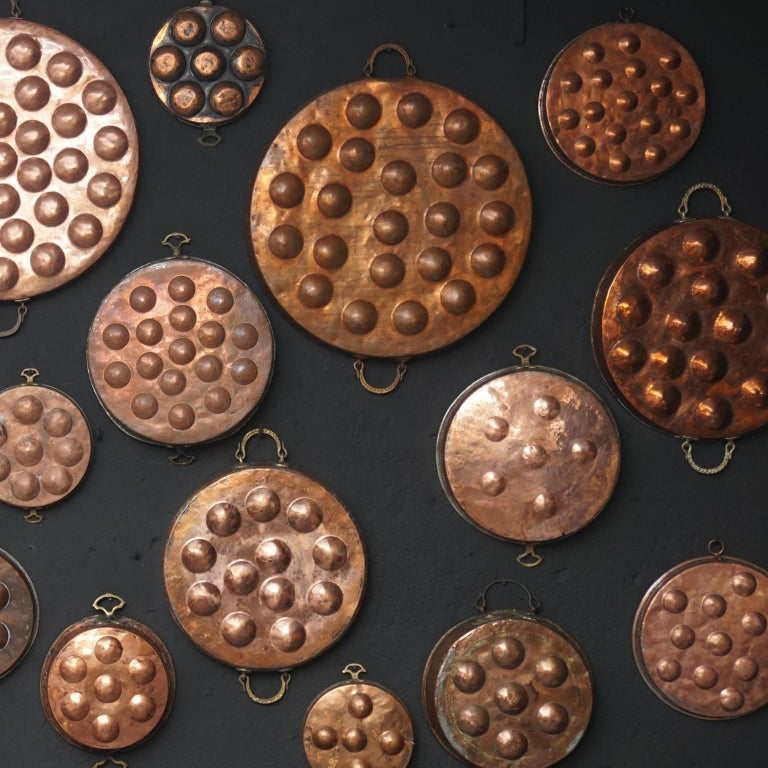 Brass Collection of Fifteen 19th Century French Copper Egg Poacher or Escargot Pans For Sale