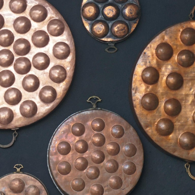 Collection of Fifteen 19th Century French Copper Egg Poacher or Escargot Pans For Sale 2