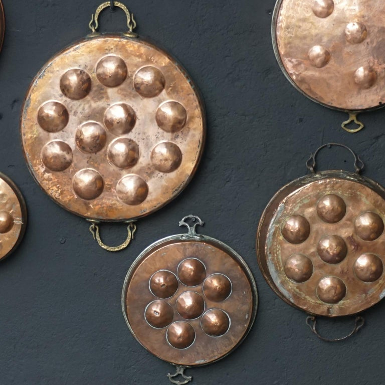 Collection of Fifteen 19th Century French Copper Egg Poacher or Escargot Pans For Sale 4