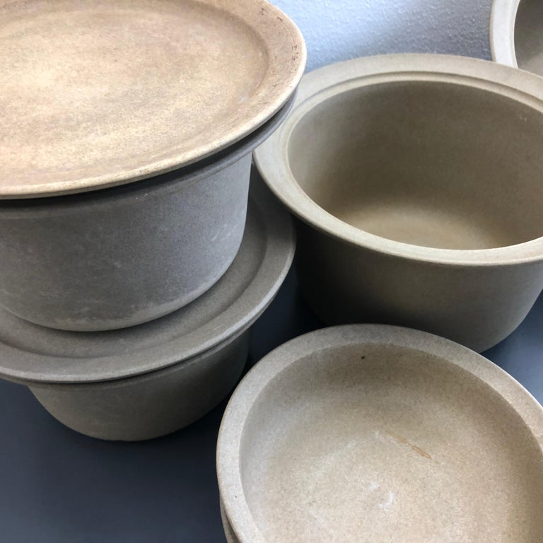A set of Firepot pots from Royal Copenhagen, designed by Grethe Meyer in 1976.  Grethe Meyer designed Fire Pot for Royal Copenhagen in 1976. The series was taken out of production around 1986.  She was asked to develop a series of fireproof dishes