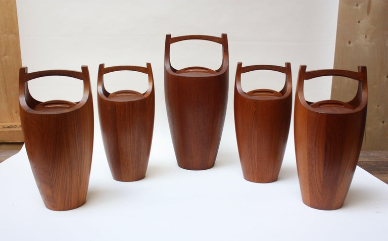 Set of four standard size and one large Dansk 'Congo' ice buckets in staved teak designed by Jens Quistgaard for Dansk. All are early Dansk Designs Denmark examples with orange plastic interior liners. Iconic, sculptural pieces being sold together