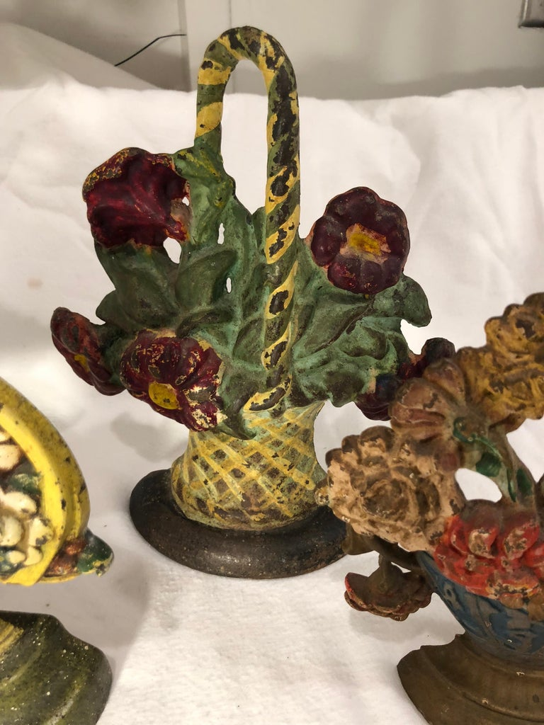 Mid-20th Century Collection of Floral Cast Iron Bookends For Sale