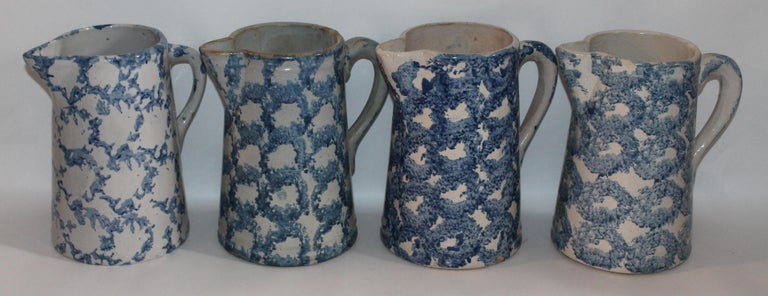 Design pattern sponge ware pitchers in great antique condition. The blue and white patter is in a smoke design patter. Great age.  All sponge pitchers measure the same. Individually 695.00 each.
