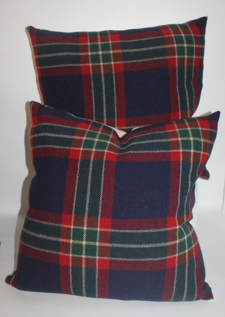 These plaid vintage Pendleton wool blanket pillows are in fine condition. We are offering the collection of two pairs of pillows in two different sizes for a great look on a sofa or bed. The backings are in blue cotton linen.  Measures: 20 x 20