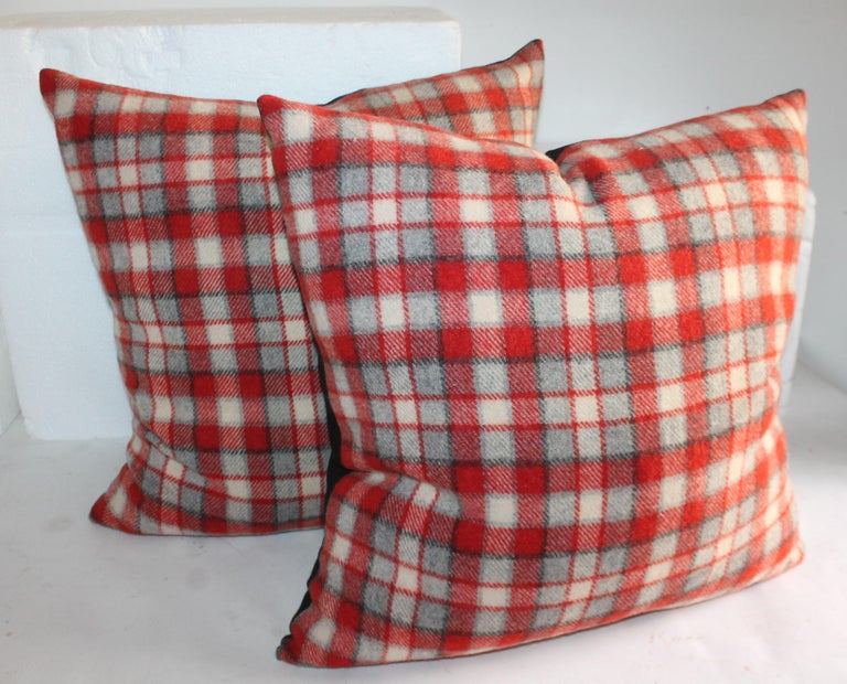 Collection of amazing plaid camp blanket pillows with red, gray, cream and black stripes. These are beautiful subtle wool pillows.