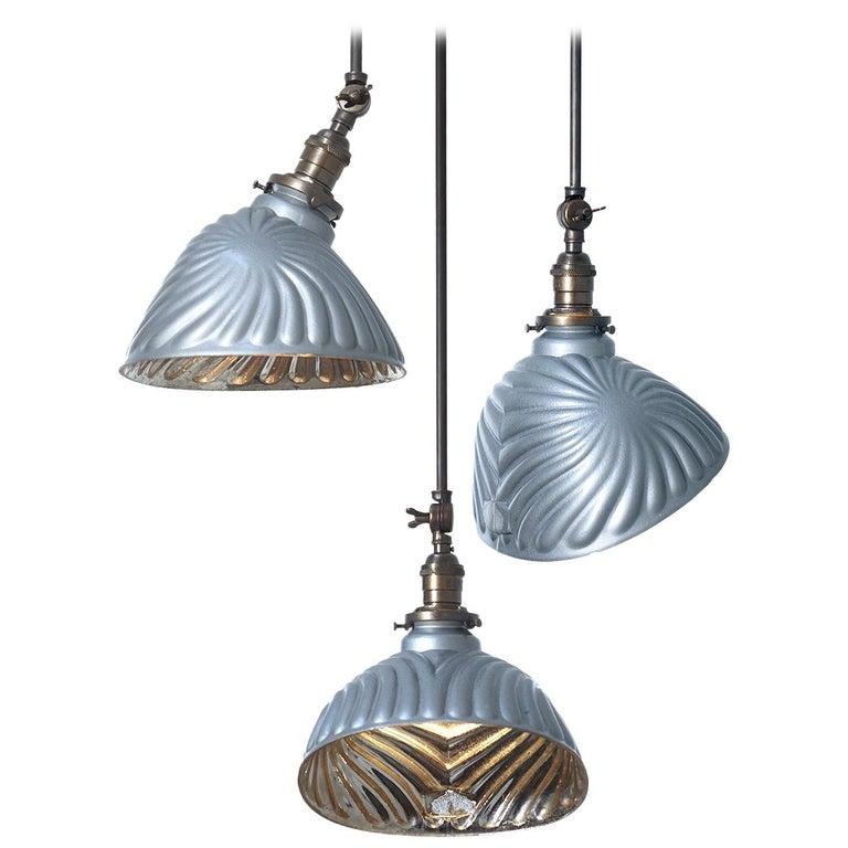 Collection of Large Sunburst Mercury Glass Pendants For Sale