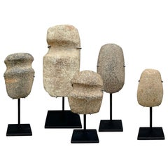 Collection of Neolithic Stone Axe Heads on Stands