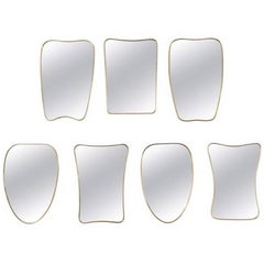 Collection of Seven Brass Framed Wall Mirrors in the Style of Gio Ponti