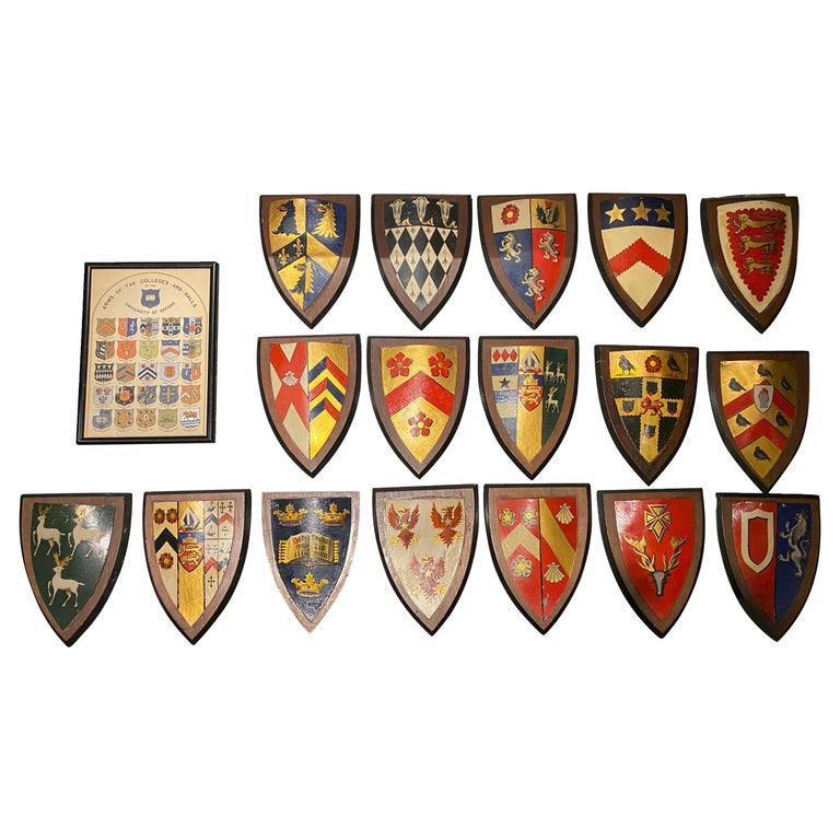 Collection of Seventeen Painted Tole Arms of the Colleges and Halls of Oxford For Sale