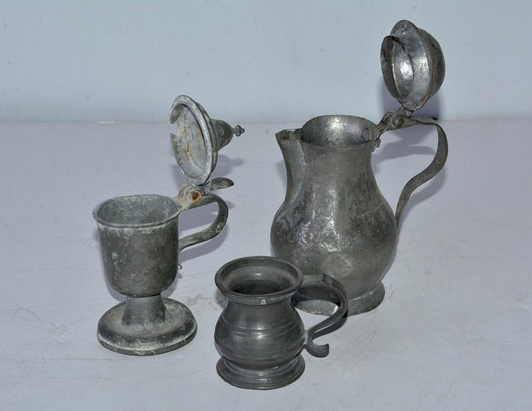 Consisting of small antique pewter barroom measuring cup or tankard, pewter pedestal jug and lidded pot making a wonderful grouping for display or decorative purposes.  Measures: Cup - D 2