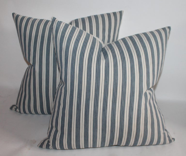 19th century Ticking Pillows with white cotton linen backs. There are one pair of 20 x 20 and one 22 x 22. 2 - 20 x 20 1 - 22 x 22.