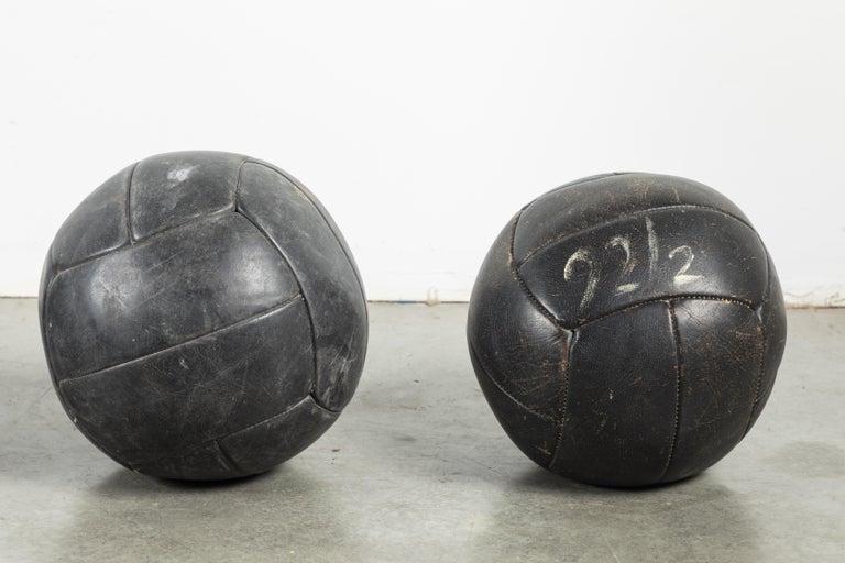 Folk Art Collection of Three Black Vintage Leather Medicine Balls For Sale