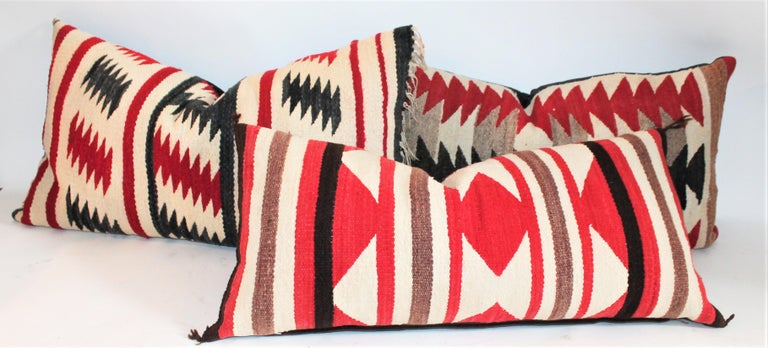 These three Navajo Indian weaving pillows are made from saddle blankets. The condition are all very good with cotton linen backings. Sold as a group of three bolsters. Purchase individually they are $995.00 each.