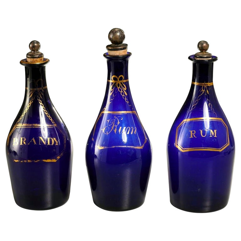 Collection of Three Rum and Brandy Early Cobalt Blue Bottles For Sale