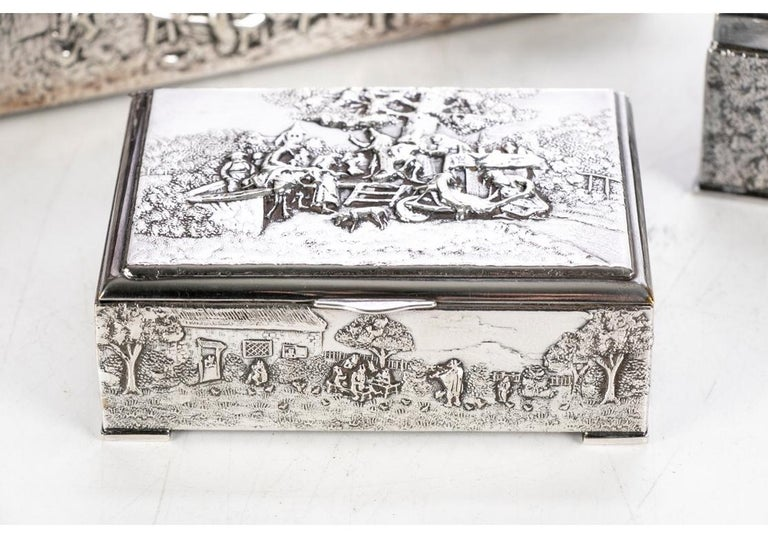 A group of three very well made and decorative Repoussé boxes with various tavern and woodland scenes. All lined in wood with leather bases.