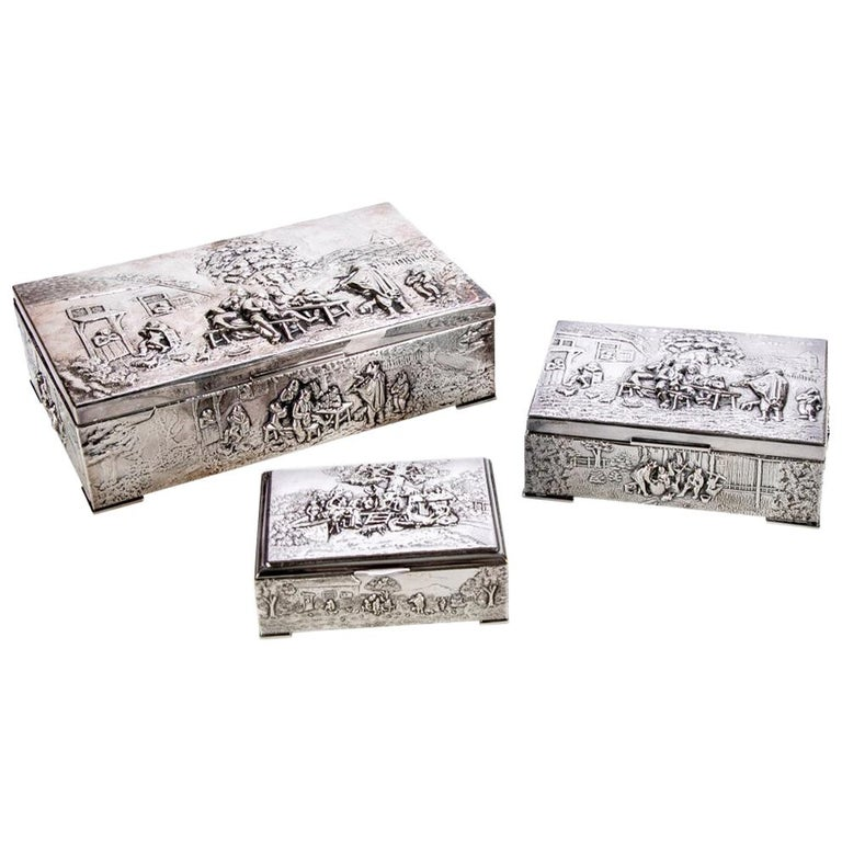 Collection of Three Silver Plate Cigarette Boxes Decorated with Genre Scenes For Sale