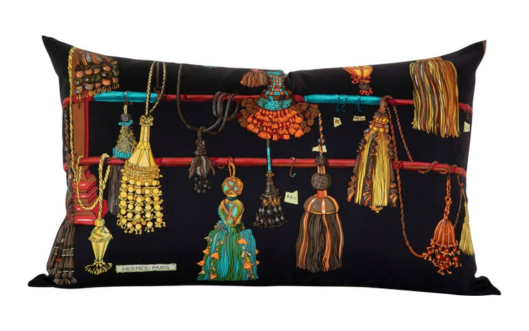 A collection of seven pillows made from vintage silk Hermes scarfs. Sold separately.