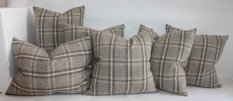 Collection of wool plaid pillows in pairs. Cotton linen backing on pillows. Three pairs of pillows. These are made from a handwoven poncho.