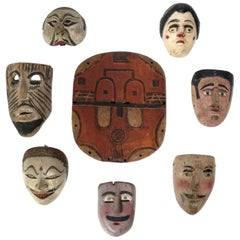 Collection of Worldwide Traveler's Hand Carved Folk Art Masks