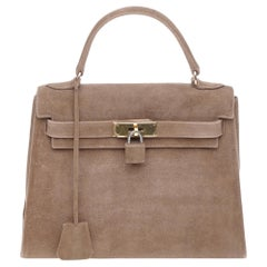 Collector Hermès Kelly 25 Doblis in brown suede and gold hardware