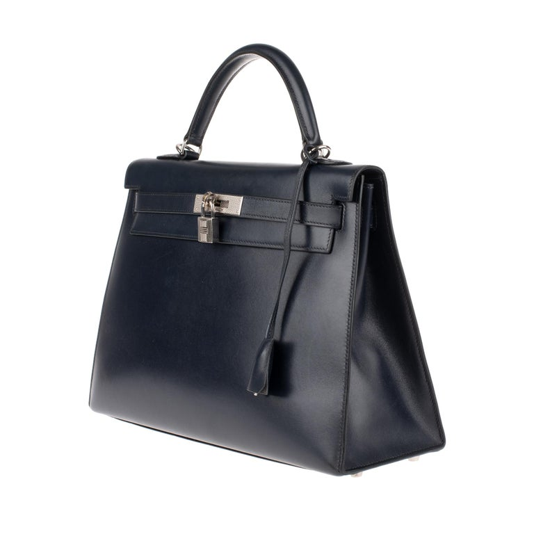 Stunning Gem and very rare collector piece very limited edition) : Hermes Kelly handbag 32 navy blue calfskin box leather , palladium silver metal trim, simple handle in navy leather, Shoulder strap in navy leather box for carrying hand or