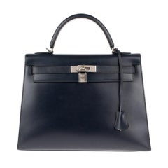Collector Hermès Kelly 32 handbag with strap in navy blue calfskin box leather!