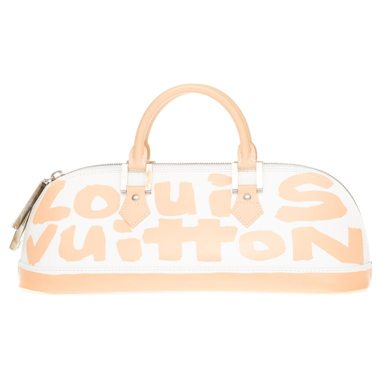 Limited edition: Louis Vuitton Alma GM bag in Graffiti Beige & White leather by Stephen Sprouse, double handle in beige leather. Double slider zipper with brand-marked charms. Beige microfiber inside, 1 patch pocket. 4 feet of LV bag. Signature: