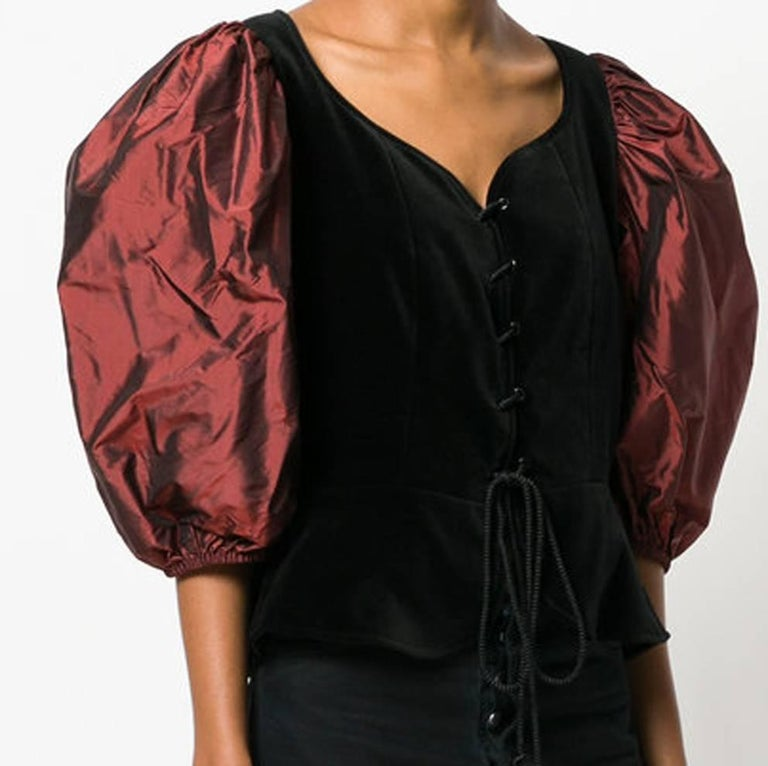 Collector winter 1996s reedition Yves Saint Laurent corset top featuring a front black velvet part, puffy silk puffy sleeves, a braided front opening.  In excellent condition. Made in France.   Estimated size 38fr/US6 /UK10 We guarantee you will