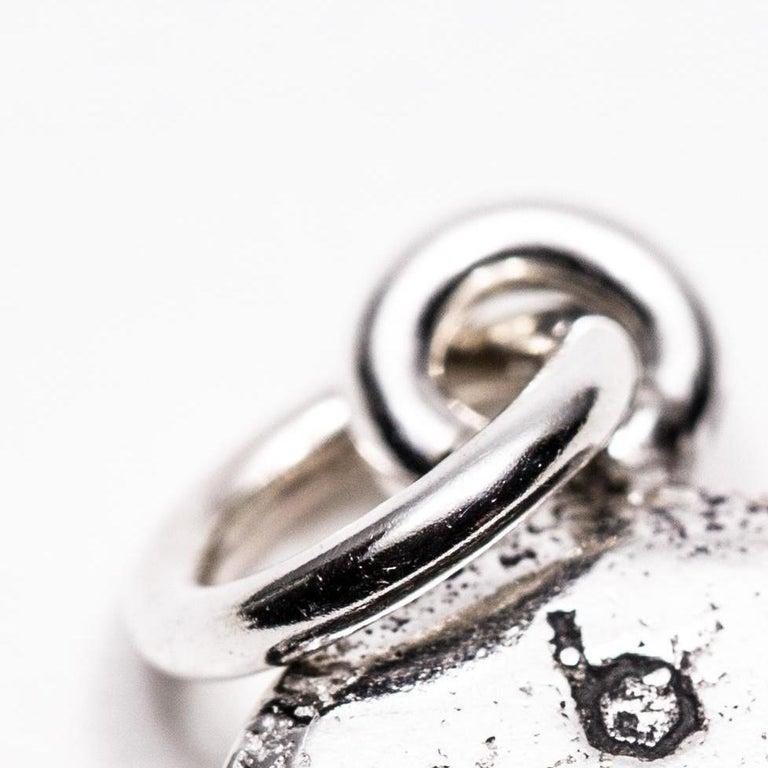 Untitled pendant (b 972 1 0, Amphetamine and Dextroamphetamine) - Silver Figurative Sculpture by Colleen Wolstenholme
