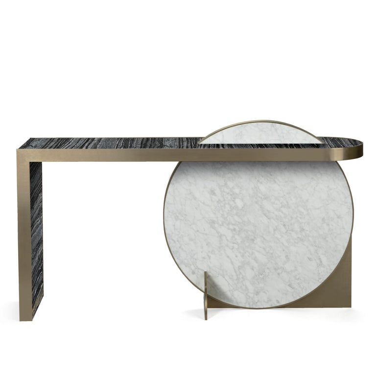 Collision console designed by Lara Bohinc for Bohinc Studio. The disk shape of this piece is inspired by the planets as part of the Lunar collection. The table is dynamically constructed using marble and brass revealing a refined luxury that