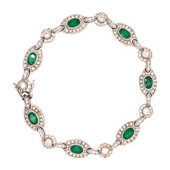 Colombia Emerald and Diamond Halo Tennis Bracelet, in 18 Karat White Gold