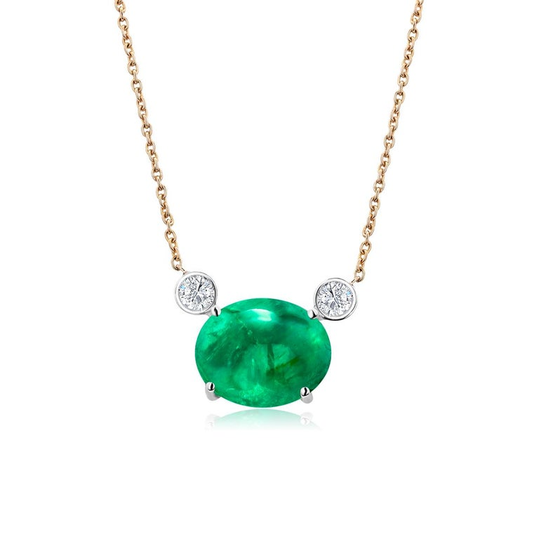 14 karats yellow gold necklace pendant with Colombia emerald Necklace measuring 16 inches long Colombia emerald-cut emerald  weighing 4.03 carats Two diamonds weighing 0.20 carats Cable chain necklace with lobster spring lock New Necklace Our design