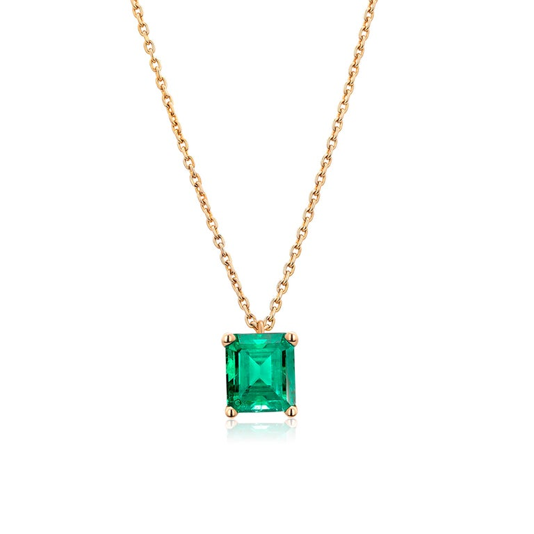 14 karats yellow gold necklace pendant with Colombia emerald Necklace measuring 16 inches long Colombia emerald-cut emerald  weighing 0.65 carats Emerald color hue is grass green Cable chain necklace with lobster spring lock New Necklace Our design