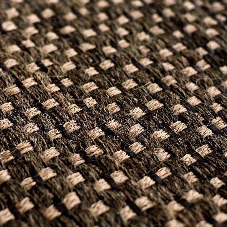 This collection pays homage to Colombian equestrian culture. Strands of horsehair (crin de caballo) are interwoven with a local jute (fique). The fique fiber gives the rugs a beautiful texture; horsehair, durability; and leather, a patina over