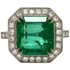 Colombian Emerald 6.52 Carat  Platinum Statement Engagement Ring