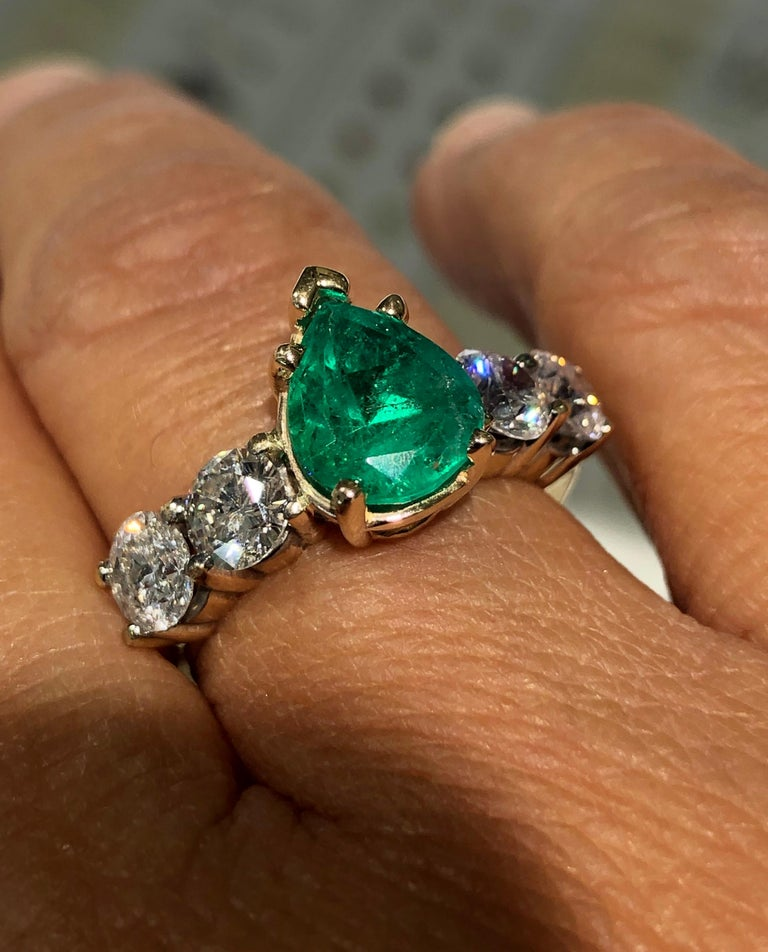 Estate Natural Colombian Emerald and Round Brilliant Cut Diamond Engagement Ring 14K Yellow Gold  Natural Colombian Emerald, Pear Cut, Color/Clarity: Medium Green/ Clarity VS. Total Emerald Weight: 2.06 carat Second Stone: Four Diamonds Round