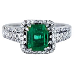 Colombian Emerald and Diamond Halo Ring, 3.38 Carat Total Weight