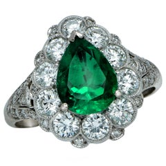 Colombian Emerald and Diamond Halo Ring