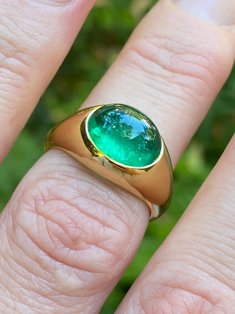 This ring features a Colombian Emerald cabochon in a hand carved wax/cast setting of 18 karat recycled gold.  -3.5 carat Colombian emerald, Muzo mines; luminous and full of life, vivid green color. Traditional oil treatment only.  -Size 7.5   Thesis